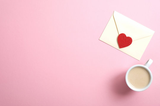 Happy Valentine's Day concept. Romantic composition with love letter and coffee cup on pink background. Flat lay, top view, copy space.