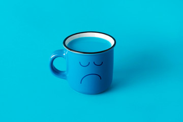 blue mug with a sad face