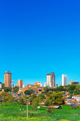 Spoed Fotobehang Blauw Skyscrapers and city buildings, Asuncion, Paraguay. City landscape. Copy space for text.