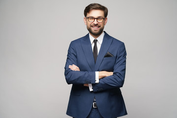 studio photo of young handsome businessman wearing suit Fotobehang