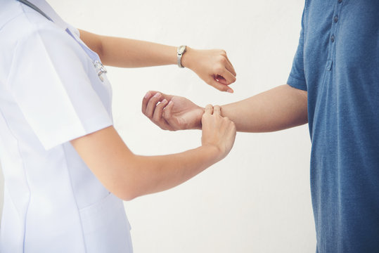 Hand doctor or nurse woman is examining check up pulse patient man