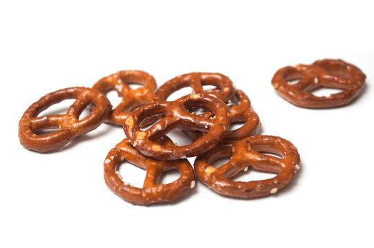 Closeup of salted pretzels on white background