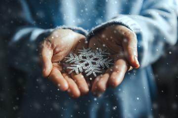 Fototapete - Woman hands holding snowflake, Christmas decorative ornament concept
