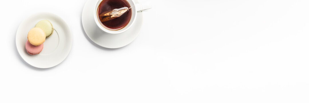 macrons and tea isolated on white banner