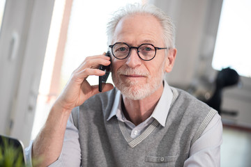 Senior businessman talking on mobile phone