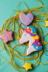 Cookies of different shapes on a turquoise background