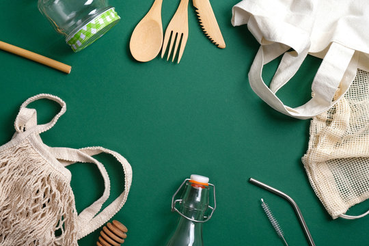 Set of Eco friendly bamboo cutlery, reusable canvas shopper bag, glass jar and bottle, string bag, metal drinking straws. Zero waste, plastic free concept. Sustainable lifestyle. Eco shop banner.