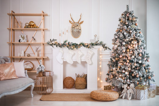 Christmas tree with gifts in the bright living room