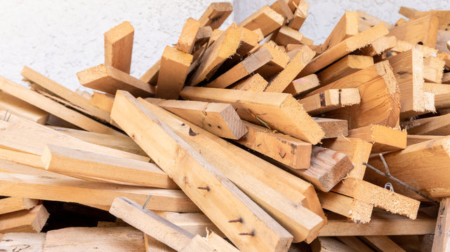 Pile of scrap wood from mattresses and palettes for recycled (up-cycled) DIY furniture making or wood carpentry projects. Wood cuts for practice or rustic craft ideas. Environmental resource saving.