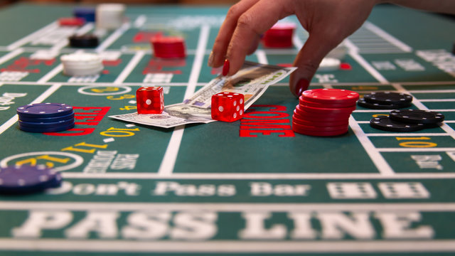 Betting $100 cash on the craps casino table