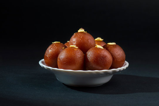 Gulab Jamun, Indian dessert topped with pistachio