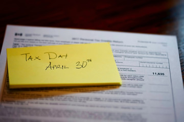 Sticky Note on Canadian Tax Form to show Canada Tax Day