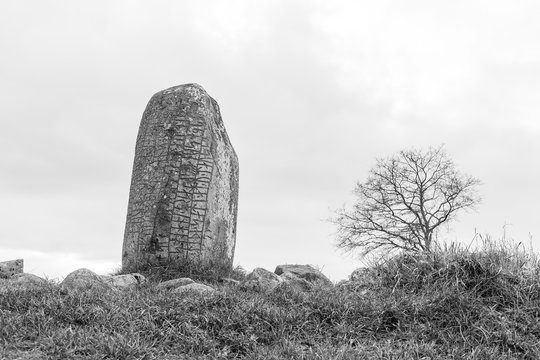 Ancient rune stone in black and white