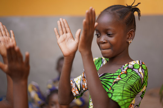 Young African Girl Concentrating On Her Hand Clapping Game
