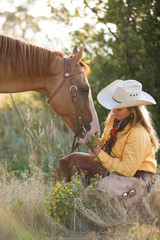 Cowgirl with horse