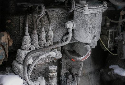 A frozen diesel engine on a winter day