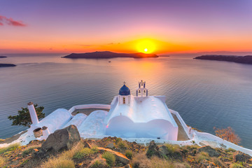 Amazing sunset at Panagia Theoskepasti, on the Skaros rock at Imerovigli, Santorini, Crete, Greece.