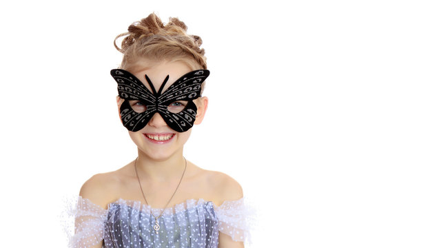 Little girl in the theatrical mask.Concept holiday, halloween, g