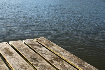 A wooden getty next to a tranquil river. Mindfulness and meditation background image.