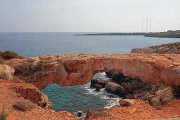 Stone arch on sea coast. Cape Greco, Aya Napa, Cyprus