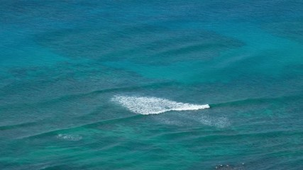 Wall Mural - Waves break over the reefs in the ocean