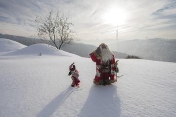 Aluminium Prints Dark grey Santa Claus on a snowy mountain winter landscape
