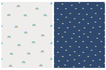 Infantile Style Seamless Vector Pattern with Hand Drawn Colorful Rainbows. Lovely Nursery Art for Fabric, Wrapping Paper, Card.Cute Print with Rainbow Isolated on a Off-White and Dark Blue Background.
