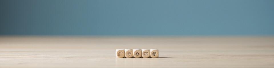Fototapeta Wooden blocks with contact icons obraz