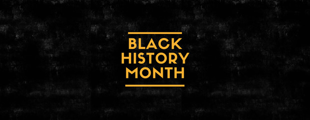 Black History Month on black grungy background and yellow color Fotomurales