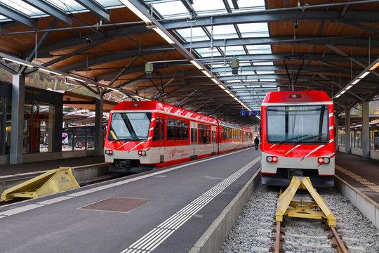Zermatt, Switzerland-October 21, 2019:The red train stop on railway at station before go to zermatt  train station