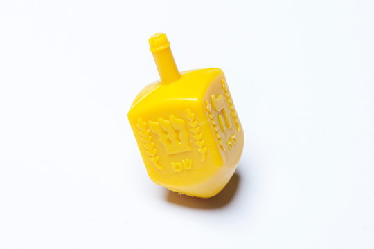 Hanukkah Jewish holiday image with a collection of wooden dreidels (spinning top) on a white background
