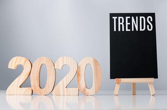 2020 trend on blackboard on grey background,business global trends concept