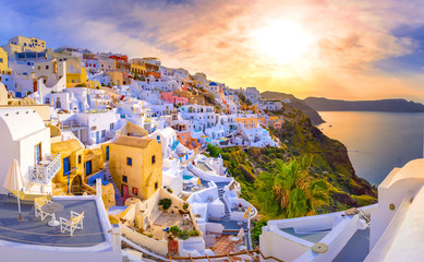 Aluminium Prints Santorini Oia town on Santorini island, Greece. Traditional and famous houses and churches with blue domes over the Caldera, Aegean sea
