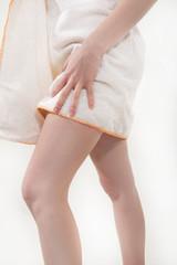 Brunette girl in a towel