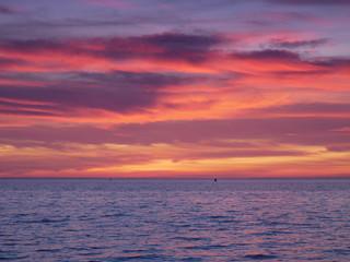 Foto op Aluminium Koraal Beautiful orange purple sunset over North Norfolk coast