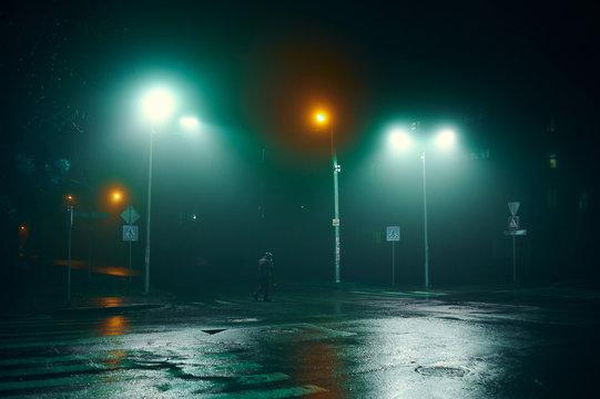 fog in the night city after rain, car headlights