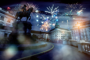 Wall Murals Vienna celebrate abstract holidays in vienna, austria, europe. christmas or new year fireworks at night. composite imagery