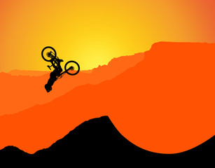 Fototapeten Rot MTB / Mountain bike Downhill Backflip in the Mountains, landscape with the setting sun behind the mountains. (with spokes at the wheels, rims)