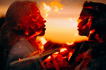 Wall Murals Dragons SIlhouette of a lesbian couple all in burning flames before passionate kissing