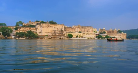 Wall Mural - Ghat and Udaipur City Palace on lake Pichola - Rajput architecture of Mewar dynasty rulers of Rajasthan. Udaipur, India. Horizontal pan