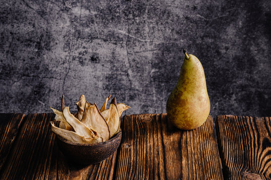 fresh pear and slices of dried pear