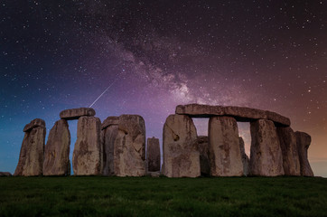 Stonehenge and at night under a star filled sky