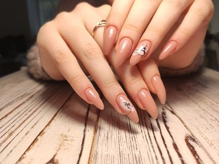 Christmas Gel Nail Design,Woman Hand Manicure painting sparkling foils. Wall mural