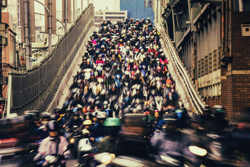 Chaos/ The crowd of people are riding scooter, shot with slow shuttle speed like waterfall in Taipei, Taiwan