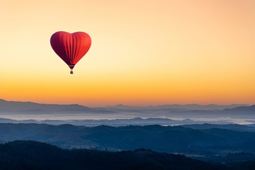 Printed roller blinds Balloon Red hot air balloon in the shape of a heart flying over the mountain