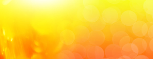abstract orange background with  bokeh lights and sunlight, panoramic background