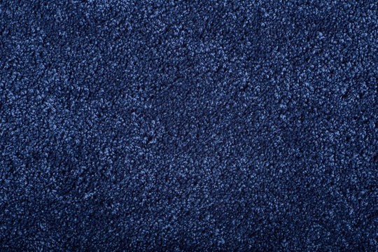 Carpet covering background. Pattern and texture of blue color carpet. Copy space.