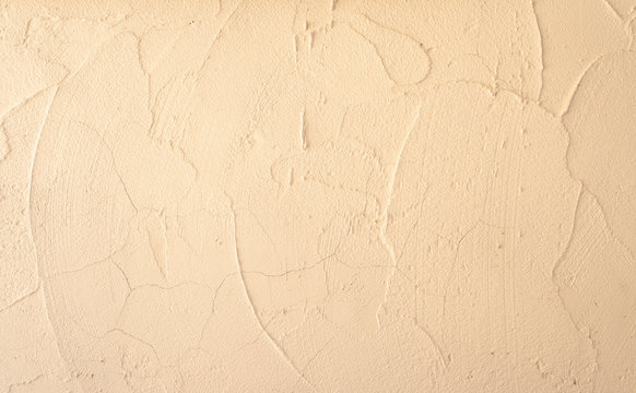 Cream and beige pastel color of rough surface mortar concrete wall with random texture cement plaster masory man's work