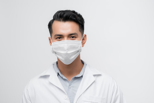Serious face of male physician looking to camera, warning on epidemic, medicine