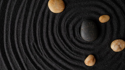 Photo sur Plexiglas Zen pierres a sable black stones in dark sand background
